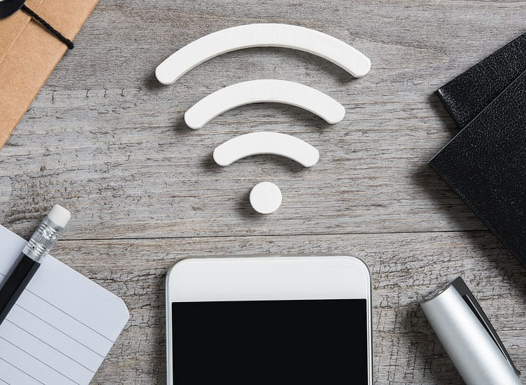 Top view of smartphone on desk searches a free wifi connection a